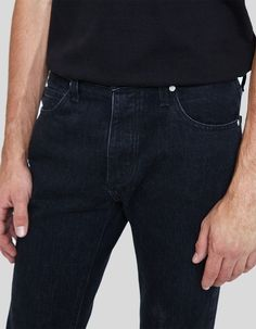 Slim jeans from NEED in Broken Black. Mid rise. Button fly with branded top button closure. Classic five-pocket styling. Branded hardware. Tonal black stitching. Slim fit through thigh and leg opening.   • No-stretch denim • 100% cotton