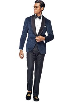 With a subtle glen check, this dark blue Manhattan tuxedo carries a modern touch while retaining an elegantly timeless appeal. Cut from Pontoglio cotton, it features a shawl collar, welt pockets, and silk-finished detailing. Top off the classic look with a white tux shirt, pair of pants, silk bow tie and black patent leather lace-ups for only $799. See it below and complete your look! Suit Supply Philadelphia