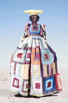 Beautiful patchwork dresses are worn by the Herero people of Namibia. Photographs by Jim Naughten
