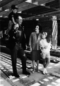 The Duke (John Wayne) with third wife Pilar and children Ethan and Aissa at their new Bayshore Estate in Newport Beach during remodelling, mid 1960s