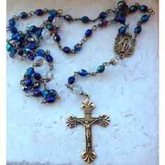 Beautifully arranged shades of blue, bronze findings, and brass accents unite in this stunning Immaculate Mary rosary. The heirloom style rosary is a splendid celebration of the gift of the Holy Rosary and the love of the Blessed Mother. Exquisitely handcrafted in USA.