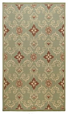 Green, red and beige Surya area rug.