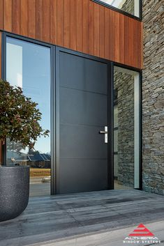 A matt black Plasma aluminium front door gives a sleek, contemporary appearance to your entranceway. See more photos of this entrance on the Altherm inspiration gallery. Modern Entrance Door, Modern Front Door, Front Door Entrance, Exterior Front Doors, House Front Door, Exterior Cladding, Front Door Design, House Entrance, Aluminium Front Door