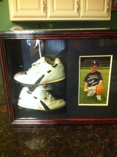 Took my son's first pair of T Ball shoes and his photograph wearing the same shoes and put them together in a shadow box. What a great memory!!