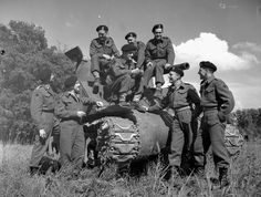 "Personnel with the Sherman tank ""Bomb"" of the Sherbrooke Fusiliers Regiment, which landed in France on D-Day and continued in action through to VE-Day. Zutphen, Netherlands, 8 June 1945 