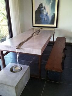 Concrete Water Feature Table - Custom concrete table with steel leg base, water recirculates through center of table. Plantable section in base around area where water pours into. Live-edge redwood benches.  Indoor/Outdoor. This set is made to order. Please contact for details and pricing.
