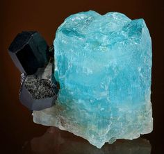 Blue crystal of Beryl var. Aquamarine with attached Schorl Tourmaline