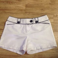 Ann Taylor Shorts Khaki colored with black trim and black buttons. Inseam 4 1/2 in. Ann Taylor Shorts