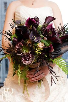 Dark purple hellebore, succulents and ferns bouquet