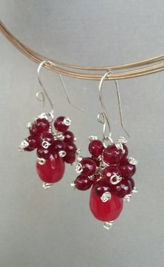 Gorgeous red cluster of gemstones https://www.etsy.com/listing/264014220/genuine-faceted-red-garnet-and-jade
