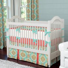 Image from http://www.babybedding.com/images/collections/coral-and-aqua-medallion-crib-bedding_large.jpg.