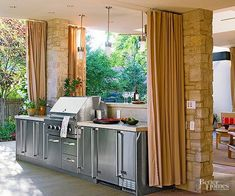 The most successful outdoor kitchens boast properly placed task lighting and protection from the elements. Protected by a roof and curtains that can be drawn to block too-bright sunlight and gusty breezes, this kitchen serves the homeowners through every season. Recessed lights and pendant fixtures illuminate kitchen surfaces, including a pass-through countertop employed to serve cocktails and fresh-off-the-grill fare.