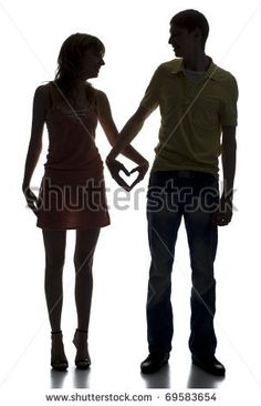 happy couple holding hands in shape of a heart