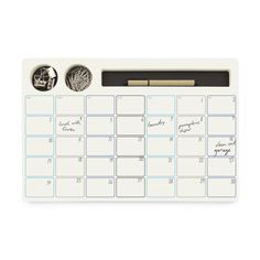 This super-cool monthly planner comes with cutout compartments for your pen, paper clips, and binder clips (all included)—it's truly a desktop essential. Paper,