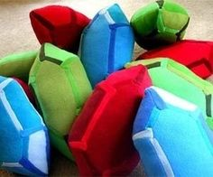 I found 'Zelda Rupee Pillows' on Wish, check it out!