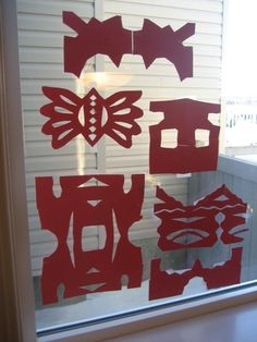 "Red paper Cut-Outs for the window for Chinese New Year! In China many windows and doors are decorated with red colour paper cut-outs representing ""happiness"", ""wealth"", and ""longevity."""