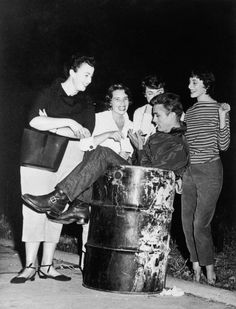 James Dean signing autographs for fans while sitting in a trash can. Always did the weirdest things and still looked cool while doing so.