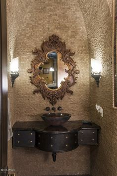 Mediterranean Powder Room with High ceiling, MS International Nordic Black Granite, Pendant light, Vessel sink, Powder room