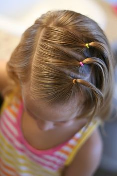 Little Girl ... with triple ponies off to the side from the top of her head