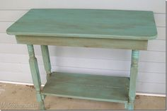 glazed turquoise table made from old crib parts and a broken table.