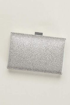 addfcd30466d Complement a shimmering dress or add a pop of sparkle to a classic look  with this allover crystal minaudiere. Embellished with rhinestones  Removable ...