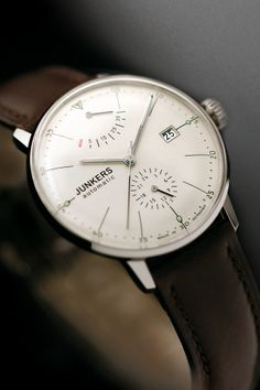 Very elegant men's watch. Slim round white face, with dark tan leather strap. Smart