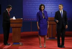 Republican presidential nominee Mitt Romney gathers his notes while President Barack Obama and his wife Michelle try to leave the stage following the first presidential debate at the University of Denver, Wednesday, Oct. 3, 2012, in Denver.