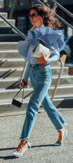 Mid-wash jeans are the perfect foil to a fresh striped flamenco shirt. Bonus points for the impressive bounce. Live from NYFW courtesy of our man on the street Tommy Ton. #styledotTon