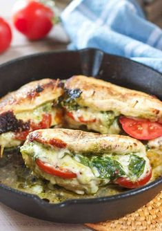 Pesto Mozzarella and Tomato Stuffed Chicken Breasts (with Video) is part of Mozzarella chicken - This amazing Pesto Stuffed Chicken recipe comes together in one skillet and takes only 30 minutes! Stuffed with Pesto, Tomatoes and Mozzarella cheese! Healthy Chicken Recipes, Healthy Dinner Recipes, Low Carb Recipes, Cooking Recipes, Recipes With Pesto, Cooking Ideas, Yummy Recipes, Easy Stuffed Chicken Recipes, Vegan Recipes
