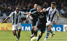 Gareth Bale made up for the absence of Cristiano Ronaldo and Karim Benzema, scoring late in Real Madrid's 1-0 win at Real Sociedad on Saturday to keep alive his team's hopes of winning the Spanish League.  Bale scored with a firm header after a well-placed cross by Lucas Vazquez in the 80th minute, giving Madrid its 10th-straight league win and putting pressure on Barcelona and Atletico Madrid.