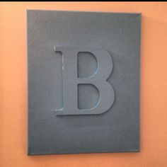 DIY Initial Canvas... Glued a wooden letter on canvas and painted all one color.
