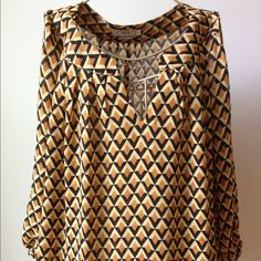 Ezra Peasant Blouse Gold and black peasant style blouse from Ezra. Worn 3-4 times. There is a pull in the right sleeve, but because the fabric pattern is geometric, it's hard to see it.  100% polyester. Hand wash cold, hang to dry. No trades or Paypal please. Ezra Tops Blouses