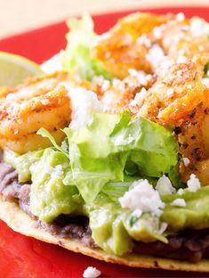 With crispy refried black beans, creamy guacamole, cool lettuce and spicy shrimp they are the perfect meal to enjoy out on your patio with a cold corona on a warm summer evening.