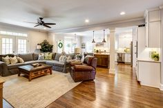 Traditional Great Room with Ceiling fan, Hardwood floors, Carpet, High ceiling, Crown molding