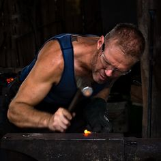 Blacksmith working. Something very sexy about a man working with steel