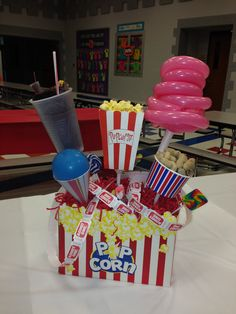 """Centerpiece with balloon """"cotton candy"""" and """"sno-cones."""""""