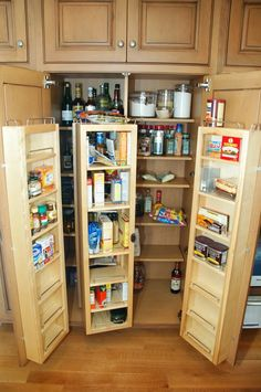 These euro-style pantries are so cool. Lori and I saw some of these in the home of Helen Guinée a number of years ago, and we thought these would really maximize storage and accessibility. Still hoping to have something like this in our future grand kitchen. :)