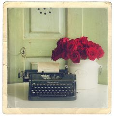 Vintage typewriters with blooms-- just appeals to me