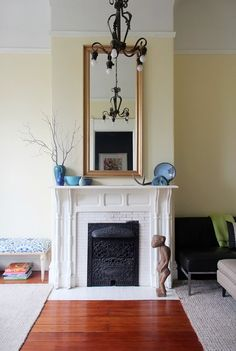 THIS is the mantel that is at my store for $100 in a stained wood!  Andi & Dean's Modern Meets Victorian