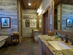 The bathroom was my favorite...notice the rock floor they put down.  Again, the lumber was reclaimed lumber.