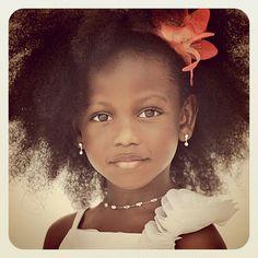 little girl +white dress + coral flower, stunning for destination wedding flower girl.  Gorgeous child!
