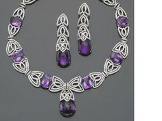 A set of amethyst, diamond and eighteen karat white gold jewelry
