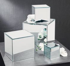 """Set of 4 Square Glass Mirror Risers 4""""h x 4""""w x 4""""d / 6""""h x 6""""w x 6""""d 8""""h x 8""""w x 8""""d / 10""""h x 10""""w x 10""""d Purchase Minimum: 1 $65.00"""