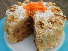 raw, vegan, grain free, paleo, carrot cake -- made with carrots, walnuts, mejool dates, shredded coconut, vanilla extract, and Chinese five spice. Frosting made with cashews, coconut oil, maple syrup, vanilla, salt, and water