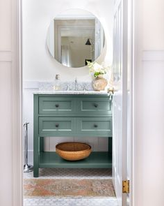Need an easy DIY room decor idea for your bathroom? Just paint your vanity! This bathroom features Current Mood, Clare's deep green paint color.