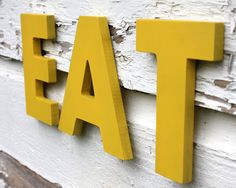 EAT wall letters, wood wall letters, choose your color. $29.00, via Etsy.