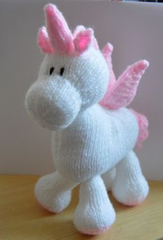 Crochet Soft Toys Knitting pattern instructions to knit Stardust the Unicorn Soft Toy Yarn : Double Knitting. white and pink, oddment of black. - Knitting pattern instructions to knit Stardust the Unicorn Soft Toy. Baby Knitting Patterns, Unicorn Knitting Pattern, Christmas Knitting Patterns, Knitting Yarn, Free Knitting, Crochet Patterns, Knitted Animals, Knitted Dolls, Double Knitting