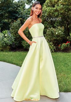 Classy prom dress 3739 by Clarisse features a straight across strapless neckline and flattering a line silhouette. The cinched waistline in encrusted in dazzling rhinestones adding the perfect sparkle while the pockets are so convenient for your phone. Simple yet classy, a lovely choice for this years prom. Find this and many more at Peaches Boutique in Chicago.