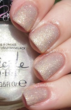Nicole by OPI Carrie Underwood Collection Sing You Like A Bee is a golden/white shimmer. layered over a nude cream.