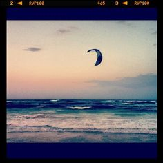 Mau (Mexican Caribbean Kitesurf's instructor) riding at sun set in Tulum.